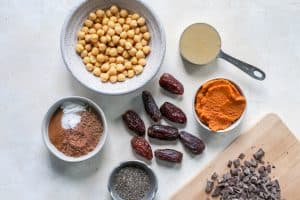chickpeas, pumpkin, sunflower butter, dates, chia seeds, and chocolate for chickpea cookies