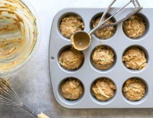 muffin tin with pumpkin muffin batter