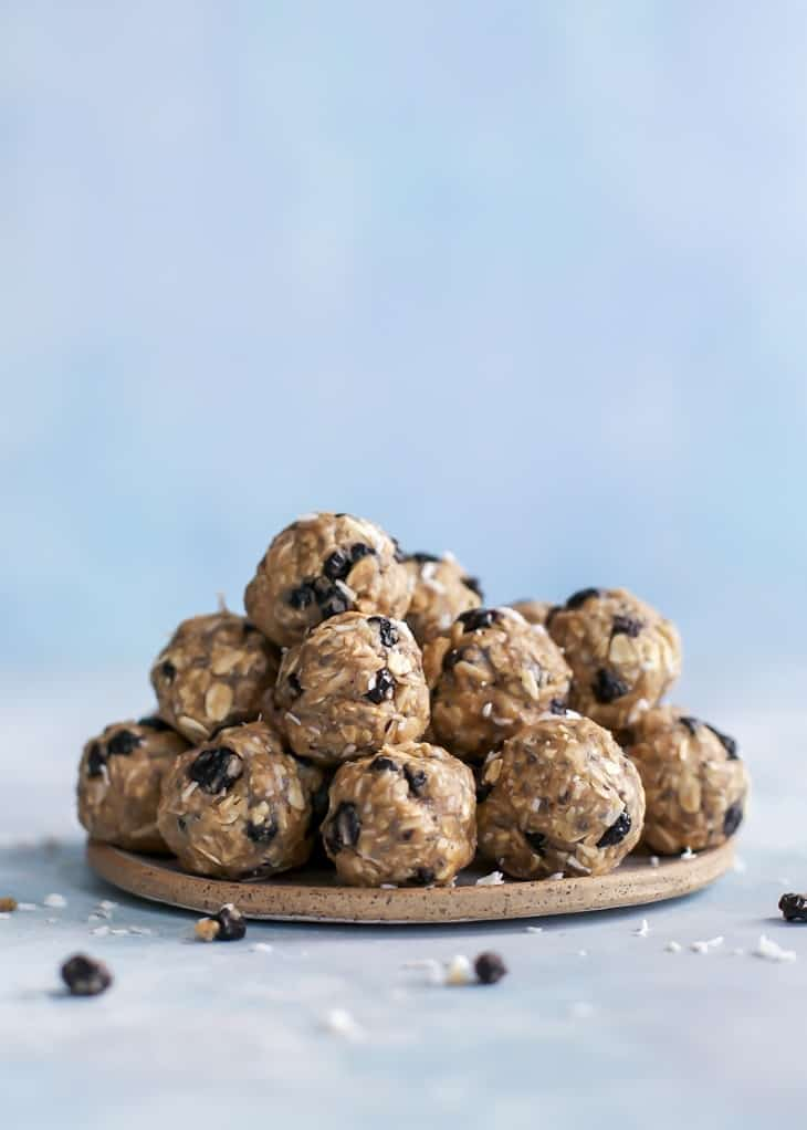 pile of energy balls with blueberries and coconut flakes