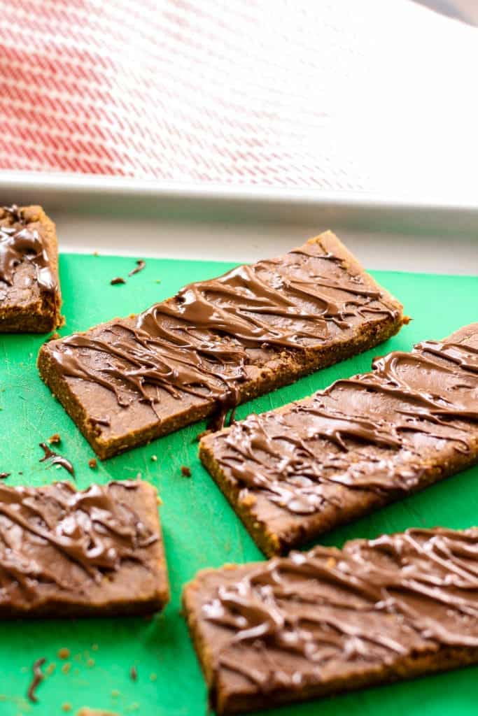 No-Bake Gingerbread Protein Bars on green cutting board