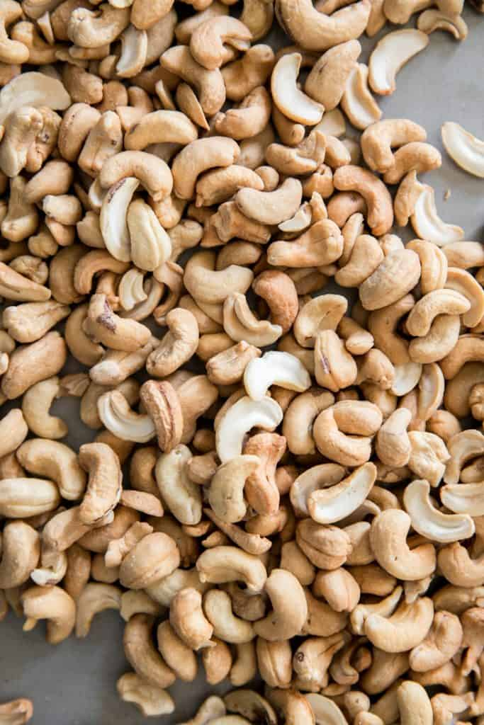 roasted cashews on baking pan