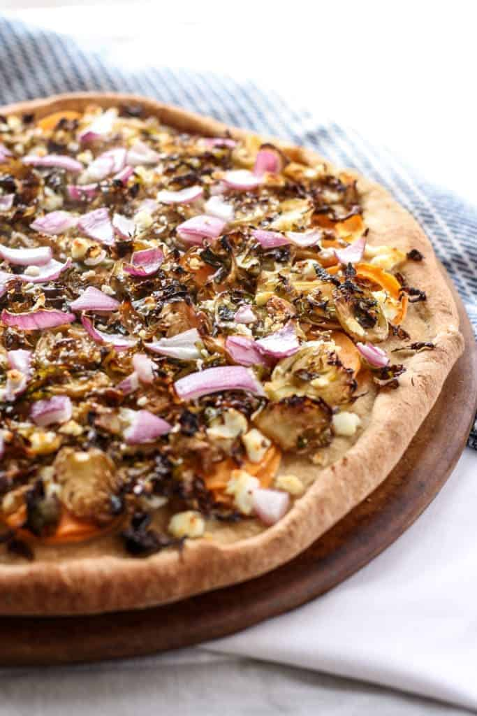 Brussels Sprouts and Sweet Potato Goat Cheese PIzza on baking stone