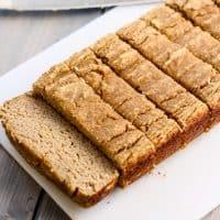 sliced paleo coconut flour banana bread on white plate