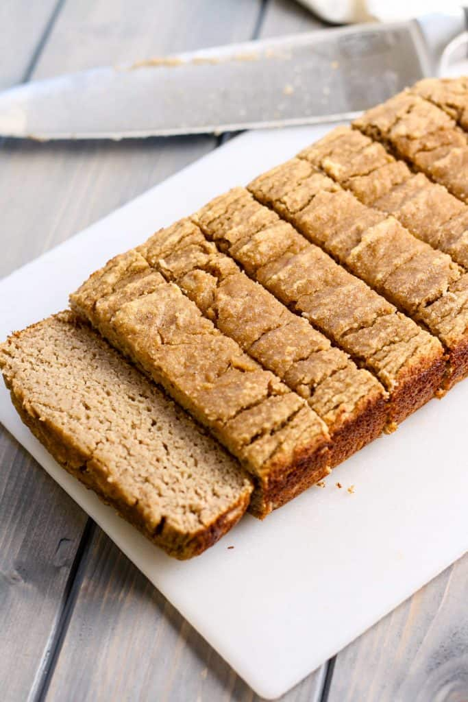 sliced paleo coconut flour banana bread on white plate