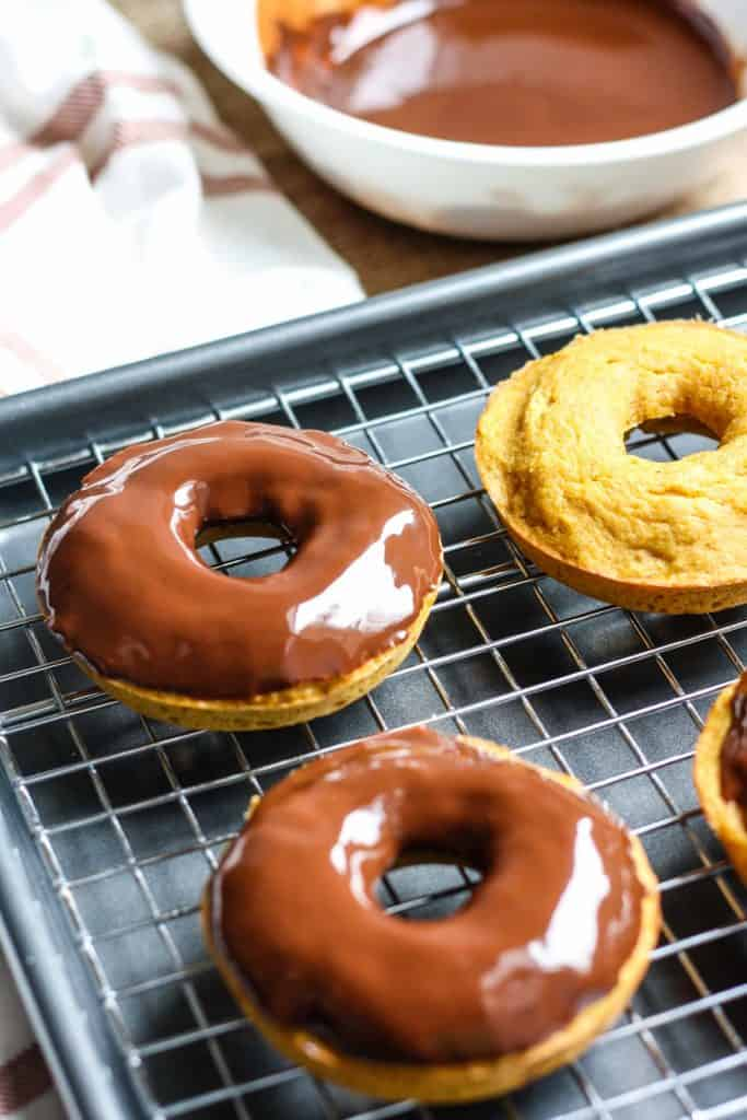 Whole Wheat Pumpkin Donuts with chocolate glaze on cooling rack