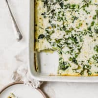 kale and feta egg bake sliced on white dishes