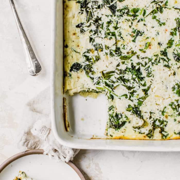 kale and feta egg bake sliced on white dishes