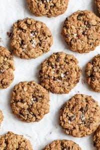 oatmeal chocolate chip cookies with sea salt on white board