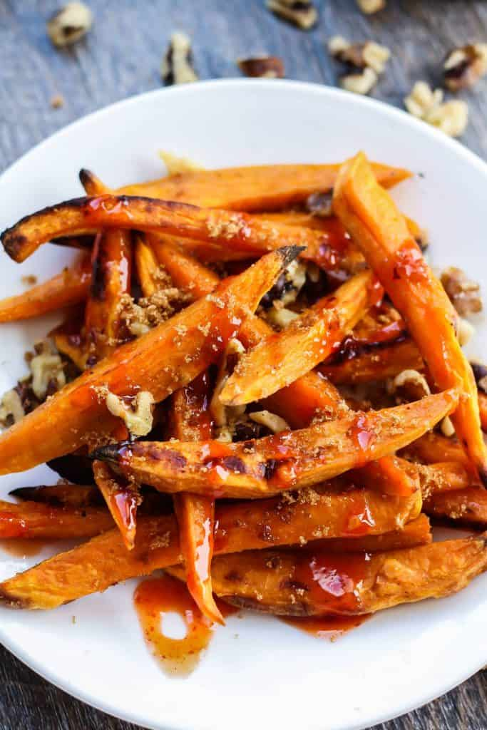 close up of Sweet Potato Fries with Walnuts, Brown Sugar, & Sweet Chili Sauce