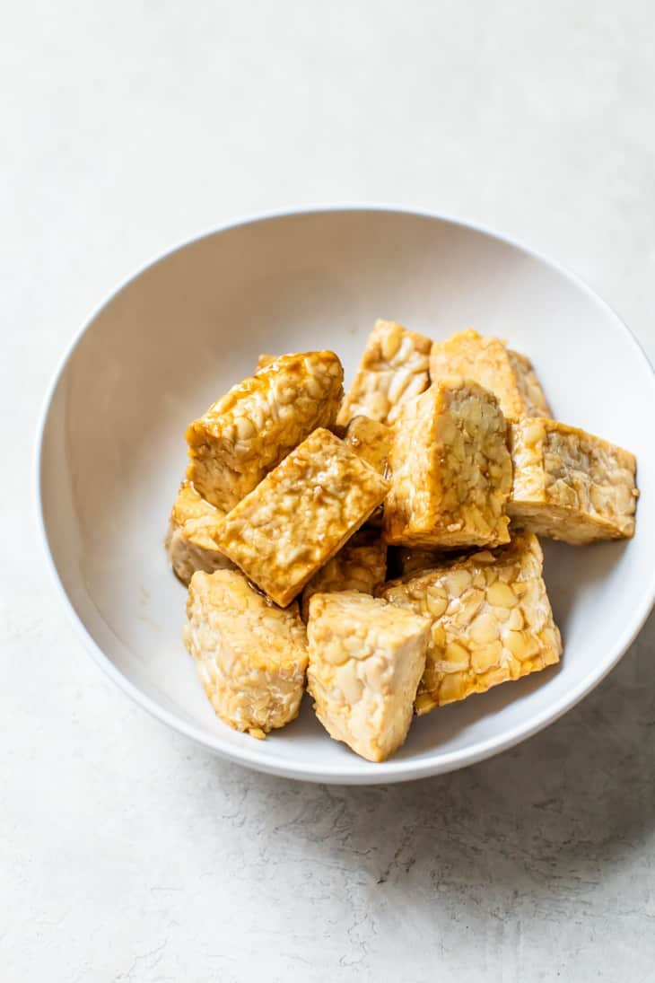marinating tempeh in bowl for buddha bowl recipe