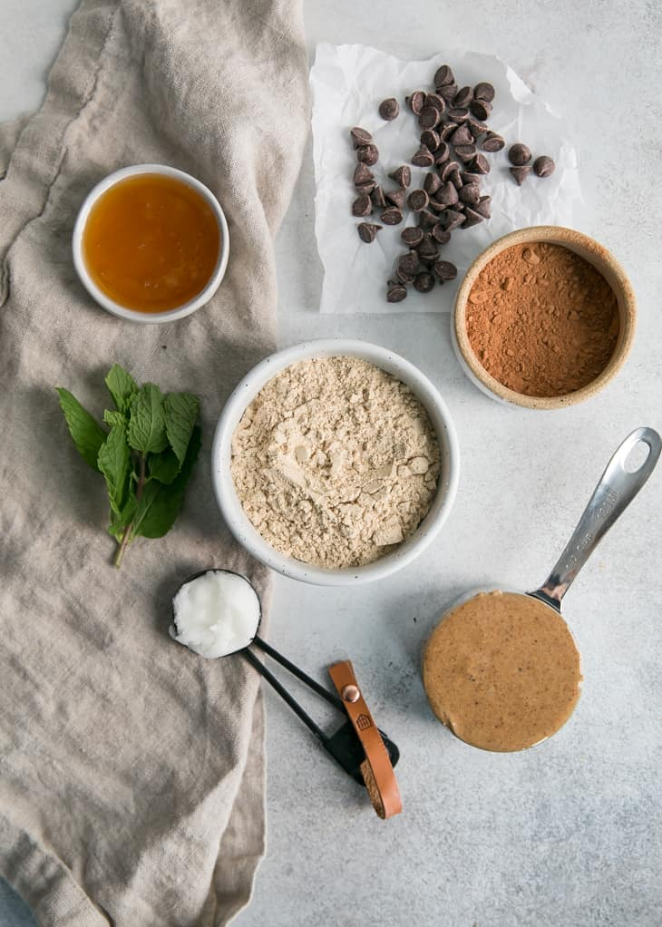 ingredients in bowls for mint chocolate protein bars