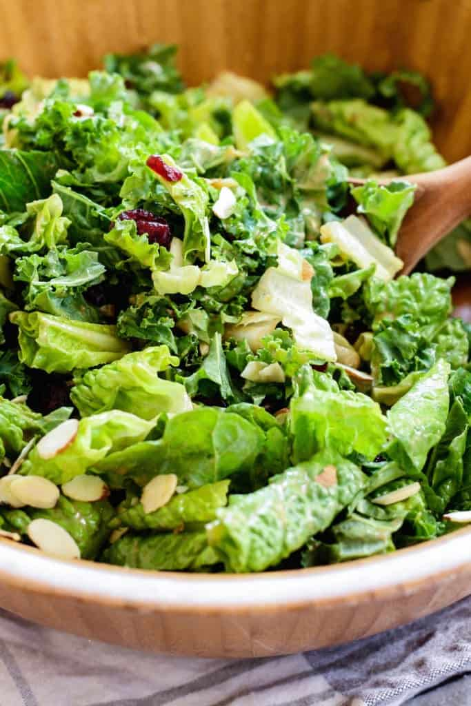 Kale and Romaine Cranberry Almond Salad in salad bowl