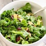 Kale and Romaine Cranberry Almond Salad. Made with a delicious homemade balsamic cashew butter dressing! Found on fitmittenkitchen.com