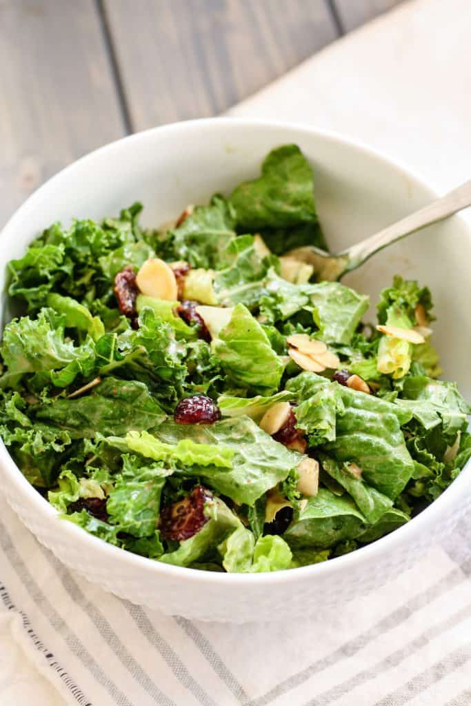 Kale and Romaine Cranberry Almond Salad in white bowl