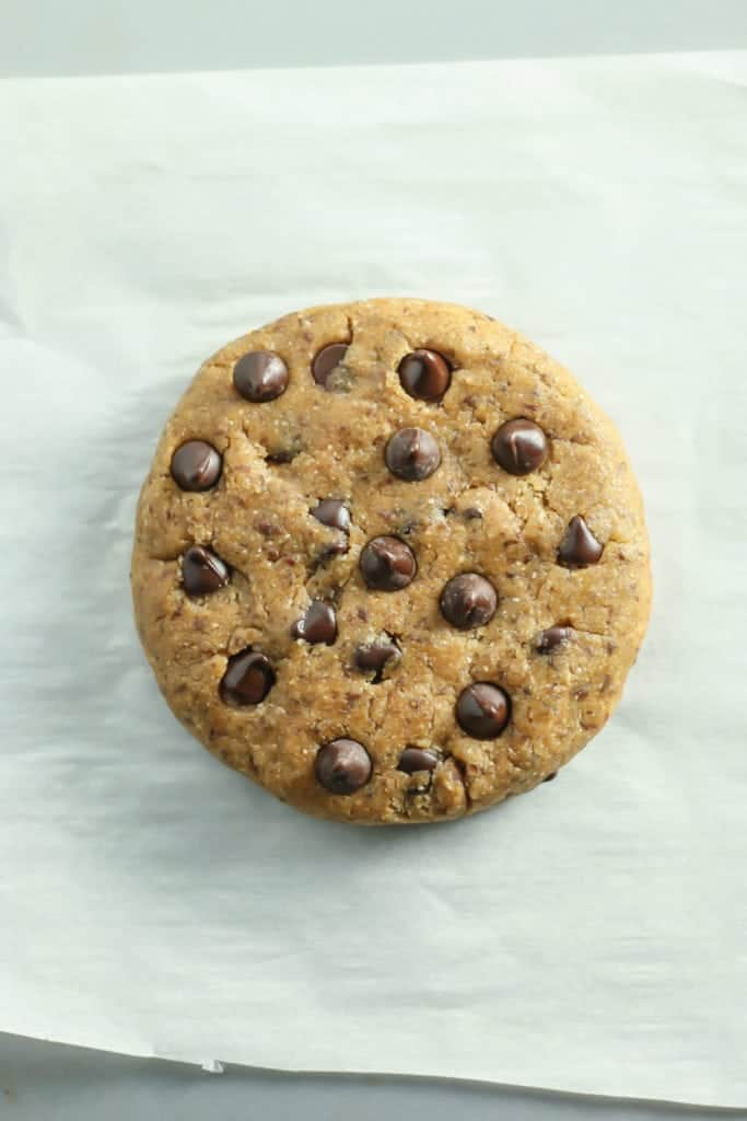 Giant Vegan Chocolate Chip Cookie on parchment paper