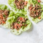 asian tempeh lettuce wraps spread out on white board