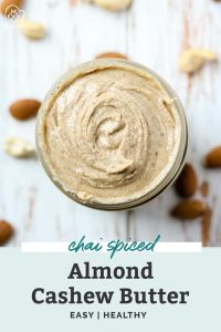 jar of chai spiced almond cashew butter with cashews and almond laying on countertop
