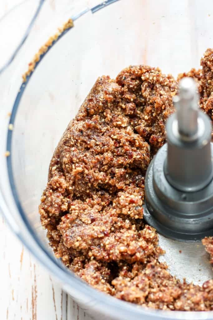 Ingredients mixed together in food processor for Ginger Berry Energy Balls
