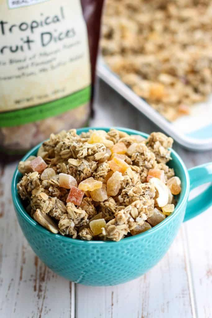 Tropical Granola in teal mug with Now Tropical Fruit Dices