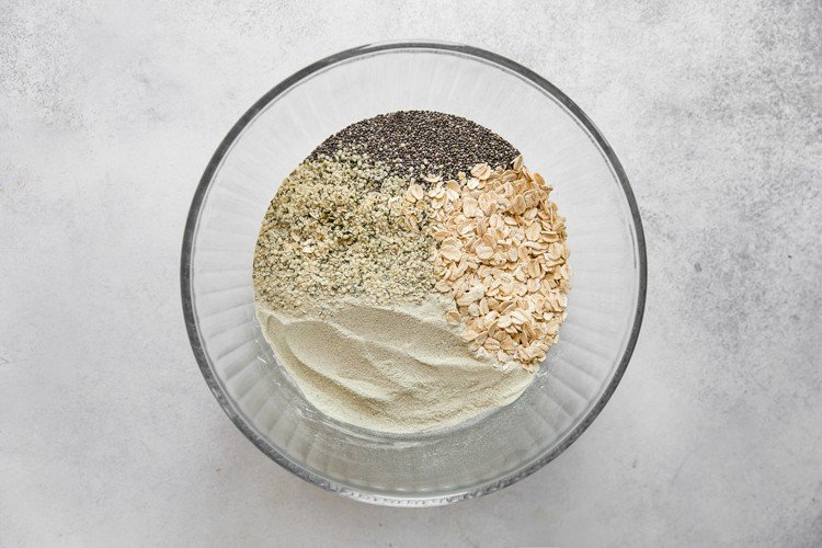 oats, hemp hearts, chia seeds and protein powder in bowl
