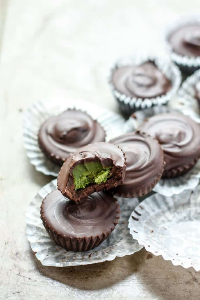 Dark Chocolate Matcha Coconut Butter Cups in candy parchment paper