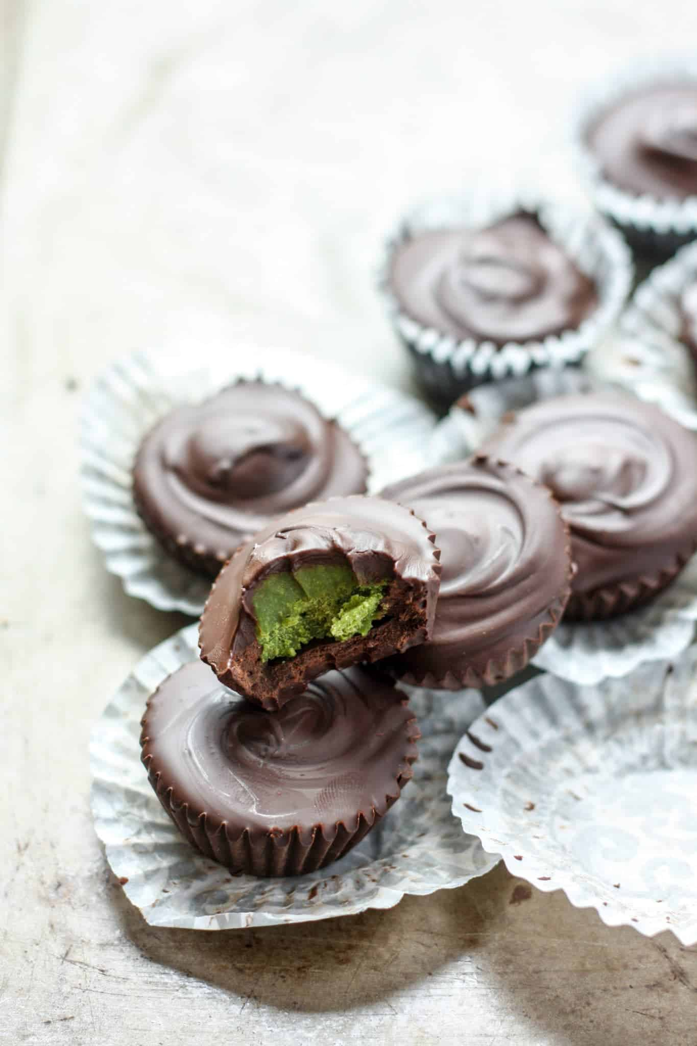 Chocolate Matcha Coconut Butter Cups in candy parchment paper