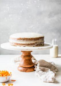vegan carrot cake cashew cream frosting on cake stand