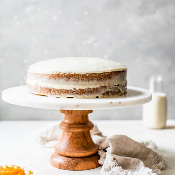 vegan carrot cake cashew cream frosting on cake stand