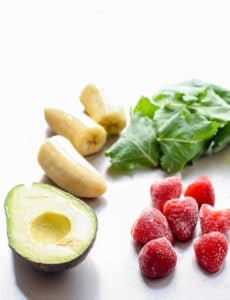 A vegan Green Strawberry Banana Smoothie with avocado for a boost of healthy fats.