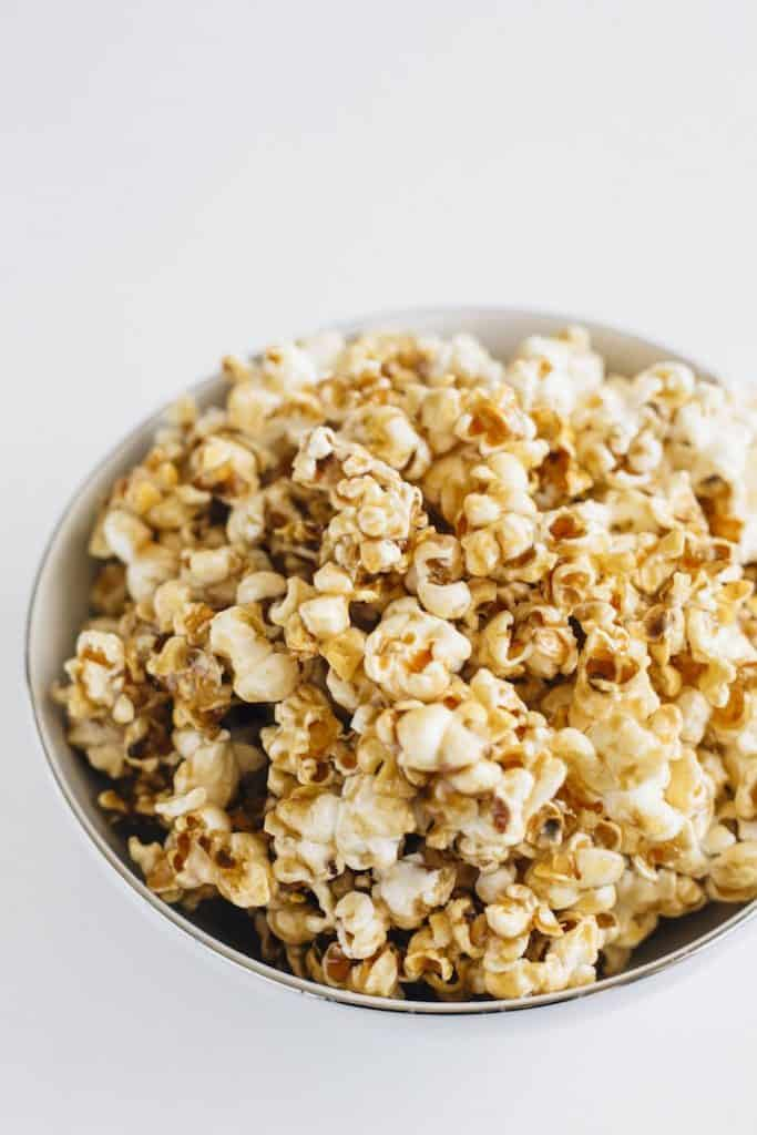 A homemade Healthy Salted Caramel Popcorn recipe using stovetop popcorn and a healthier salted caramel sauce. Recipe by The Almond Eater.