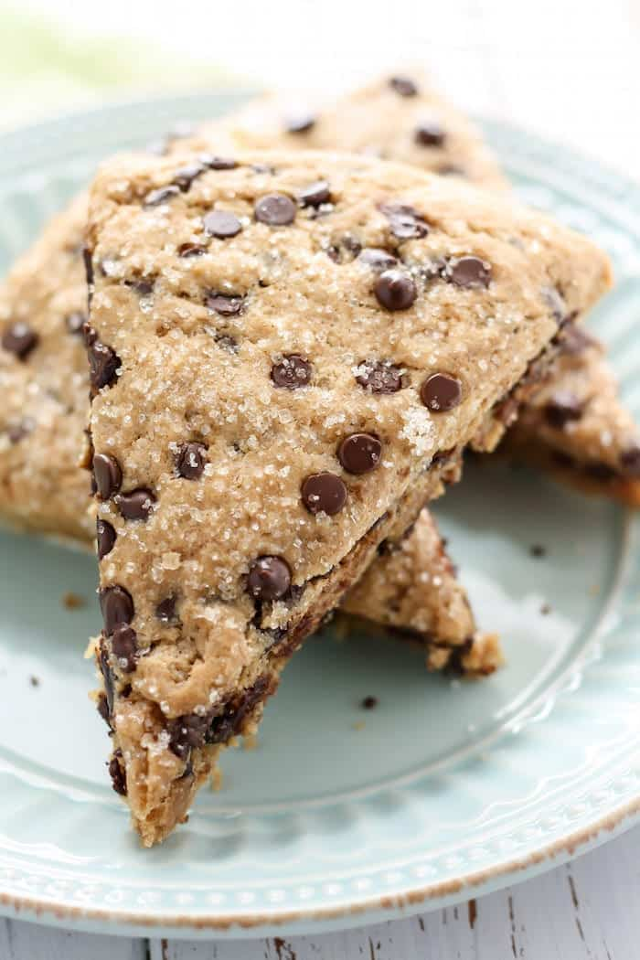 Close up of Vegan Whole Wheat Chocolate Chip Scones on light blue textured plate