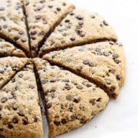 circle of vegan chocolate chip scones cut into triangle