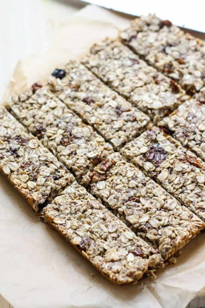 golden berry granola bars cut on parchment paper