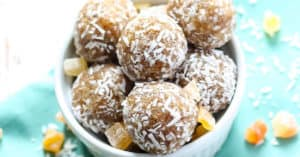 It's time to bust out your food processor! All you need is 5 ingredients and 10 minutes to make these Tropical Coconut Energy Balls.