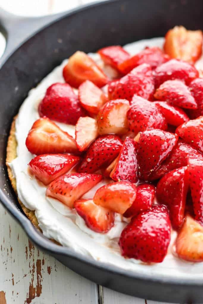 Juicy strawberries on shortcake in skillet