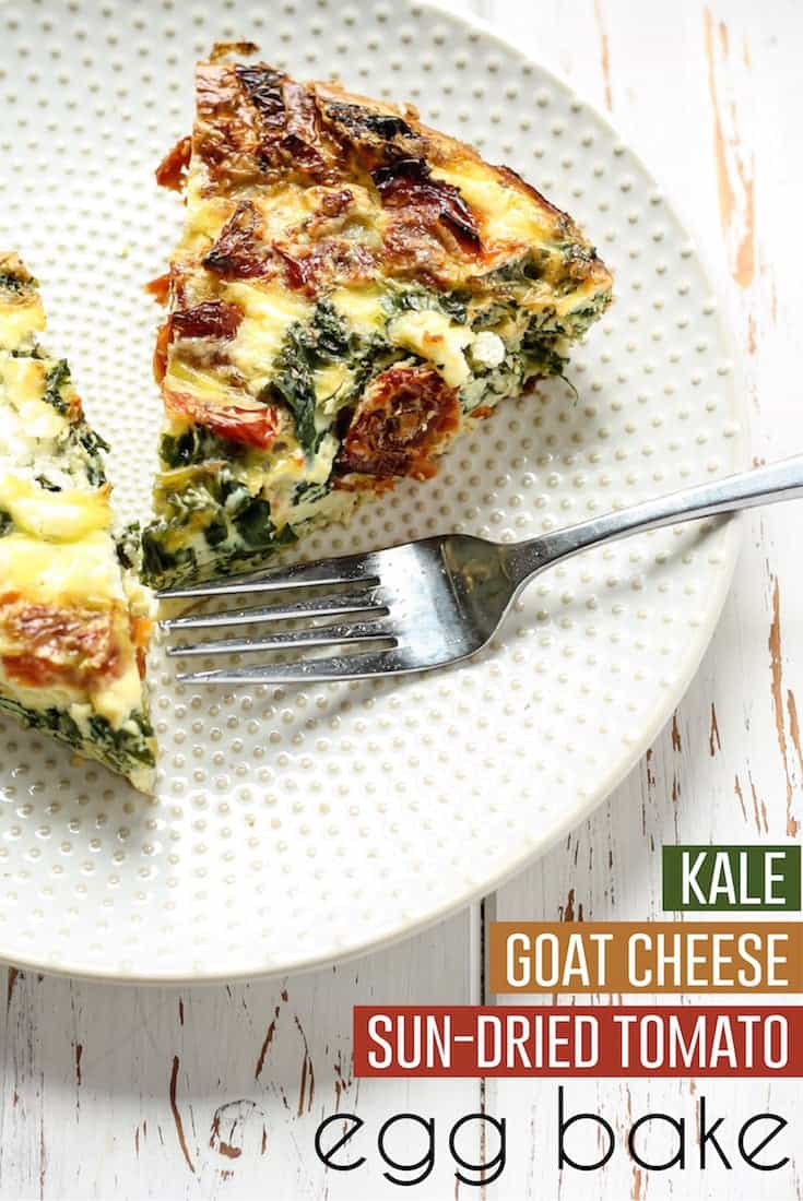 kale goat cheese and sun-dried tomato egg bake on white plate with fork