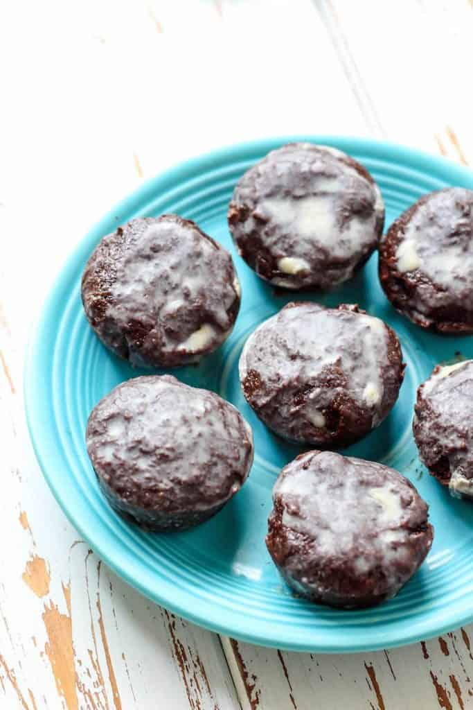 Healthy Fudgy Gluten-free Vegan Brownie Bites! Using healthy gluten-free brownie mix, banana, coconut oil, and flaxseed. Glaze with melted coconut butter for a seriously delicious treat.