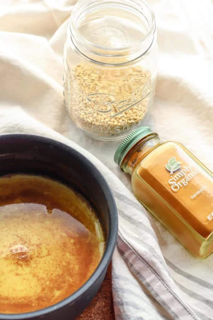 Golden Milk Overnight Oats in mason jar with simply organic turmeric spices shaker