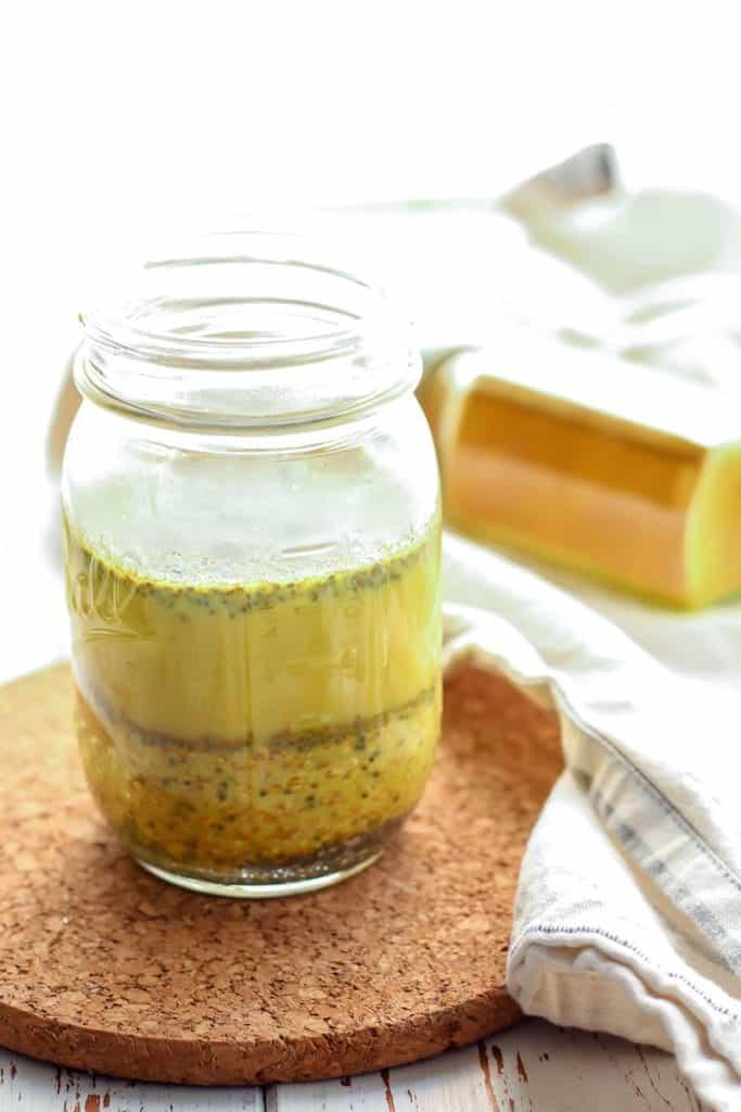 Easy Golden Milk Overnight Oats in mason jar on cork