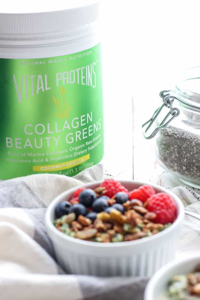 Green Goddess Overnight Oats with collagen beauty greens in white bowl with blueberries and raspberries