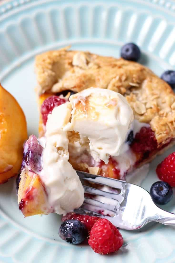 A warm, freshly sliced Whole Wheat Berry Peach Galette served with ice cream. You just can't beat it.