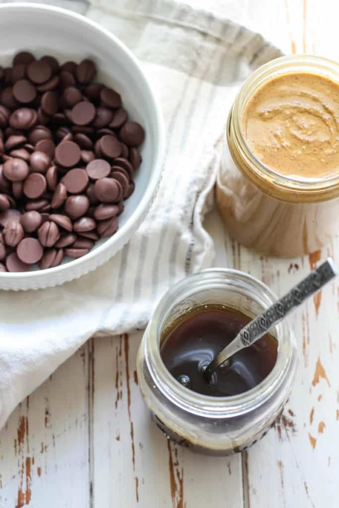 Just 3 ingredients using chocolate chips, healthier salted caramel sauce, and almond butter gets you the most delicious little cups!