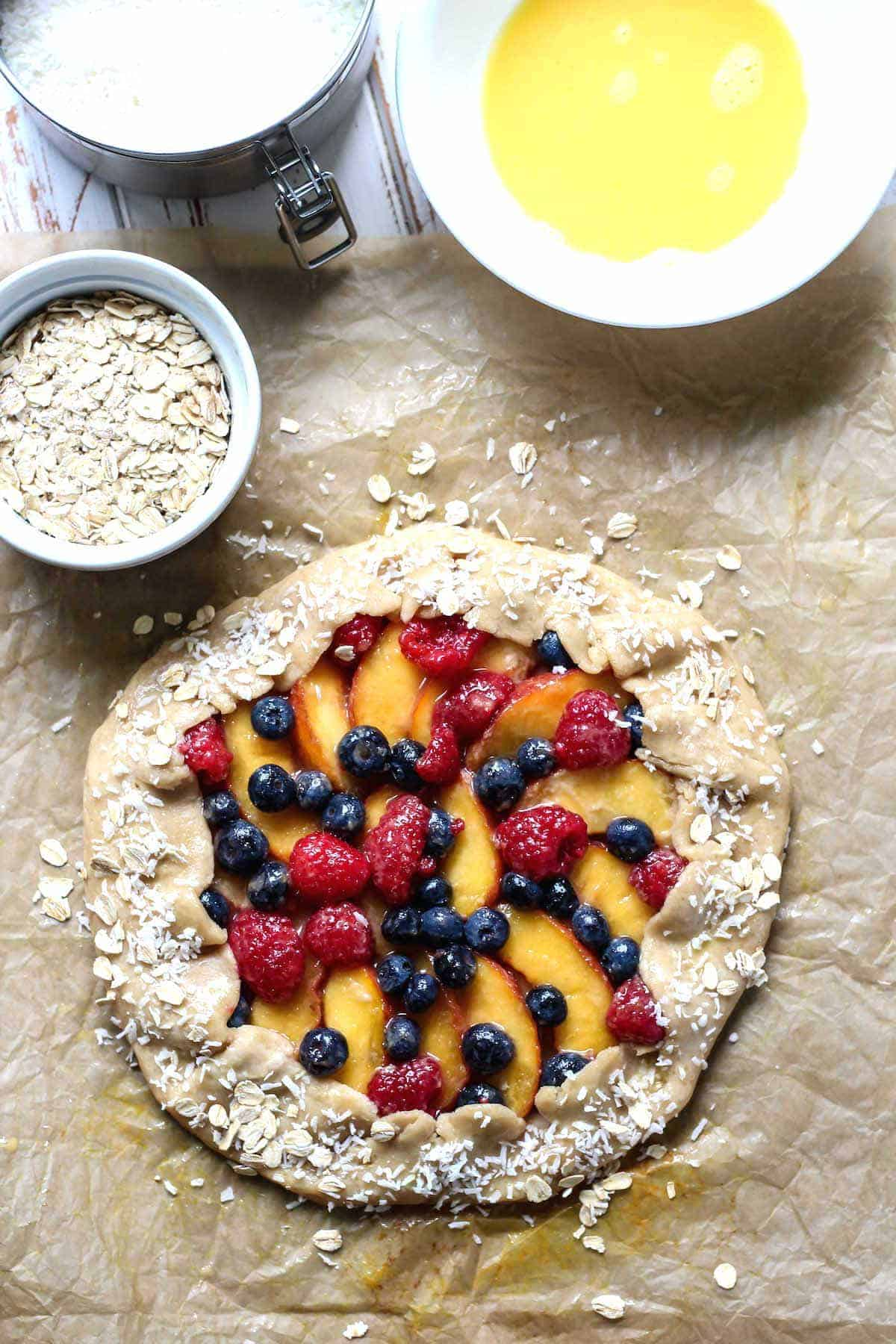 Use an egg wash on the crust to create the perfect crisp edge on this Whole Wheat Berry Peach Galette.