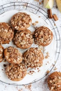 apple muffins with crumb topping on plate and wire rack
