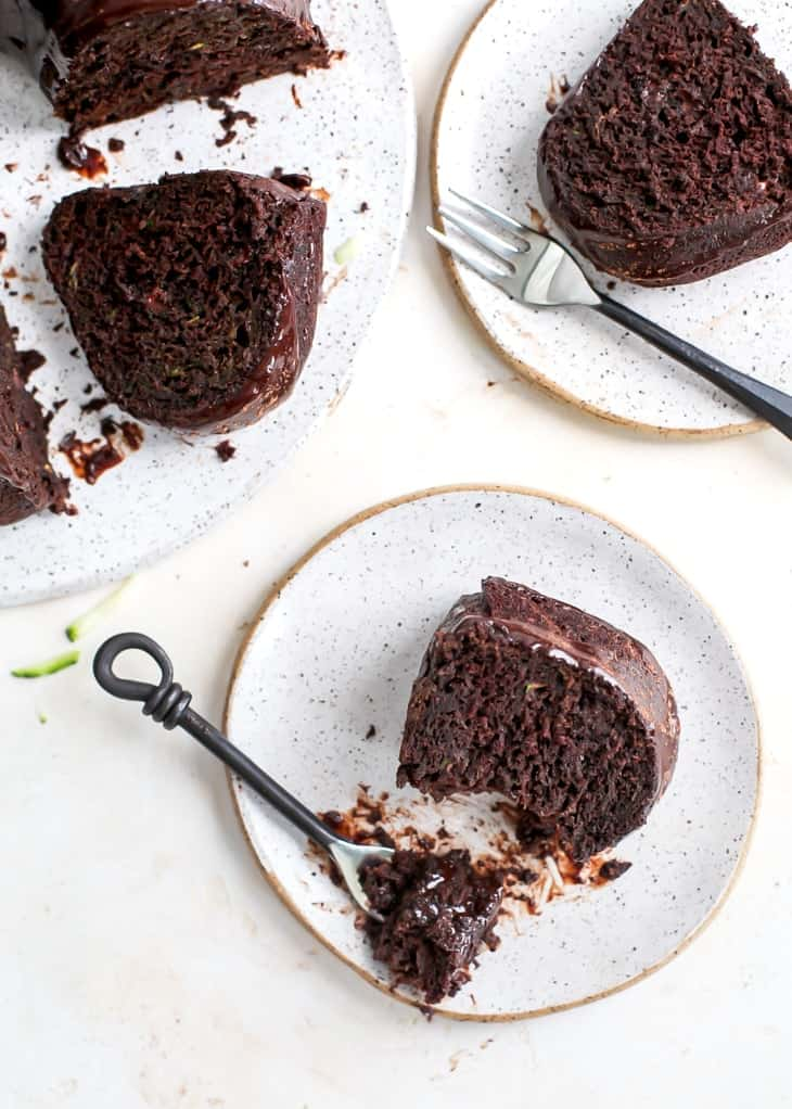 chocolate cake pieces on plate with dessert fork