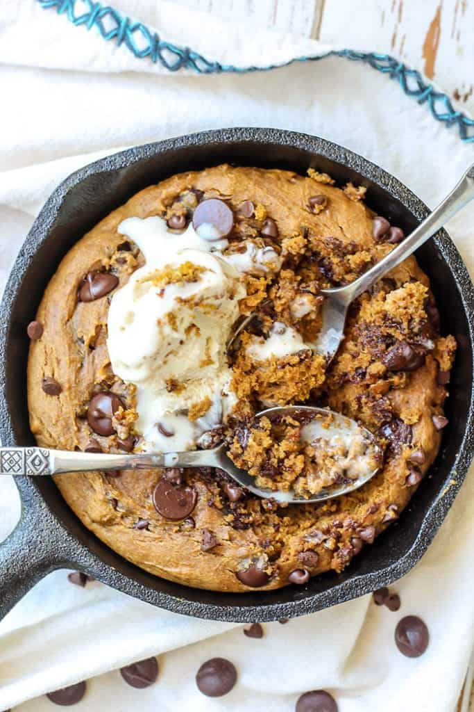 Perfect dessert for two! This Pumpkin Chocolate Chip Skillet Cookie is gluten-free and dairy-free, plus sweetened with coconut sugar and maple syrup for a healthier treat.