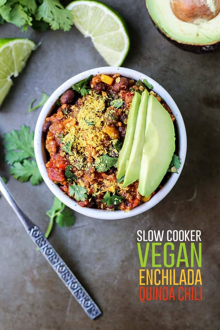 Slow Cooker Vegan Enchilada Quinoa Chili in white bowl with cilantro lime avocado