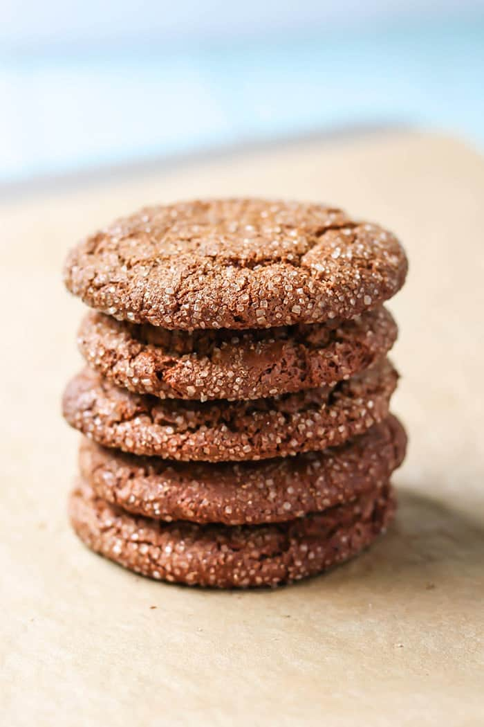Paleo Spiced Almond Butter Cookies! Cinnamon ginger and cardamom in stack on parchment paper