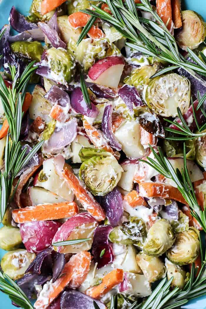 1-pan rosemary roasted vegetables with smoked sea salt and rosemary goat cheese on blue plate