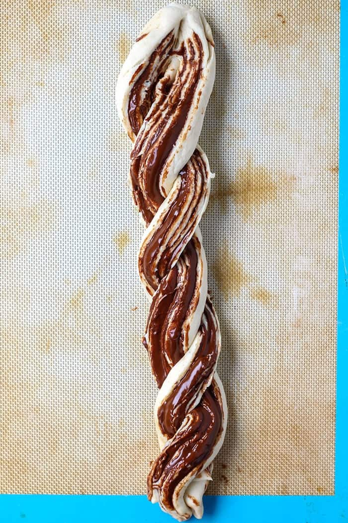 immaculate baking co crescent roll with chocolate hazelnut spread braided on baking sheet